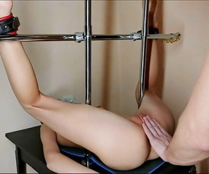 Metal Bondage Teen Girl...